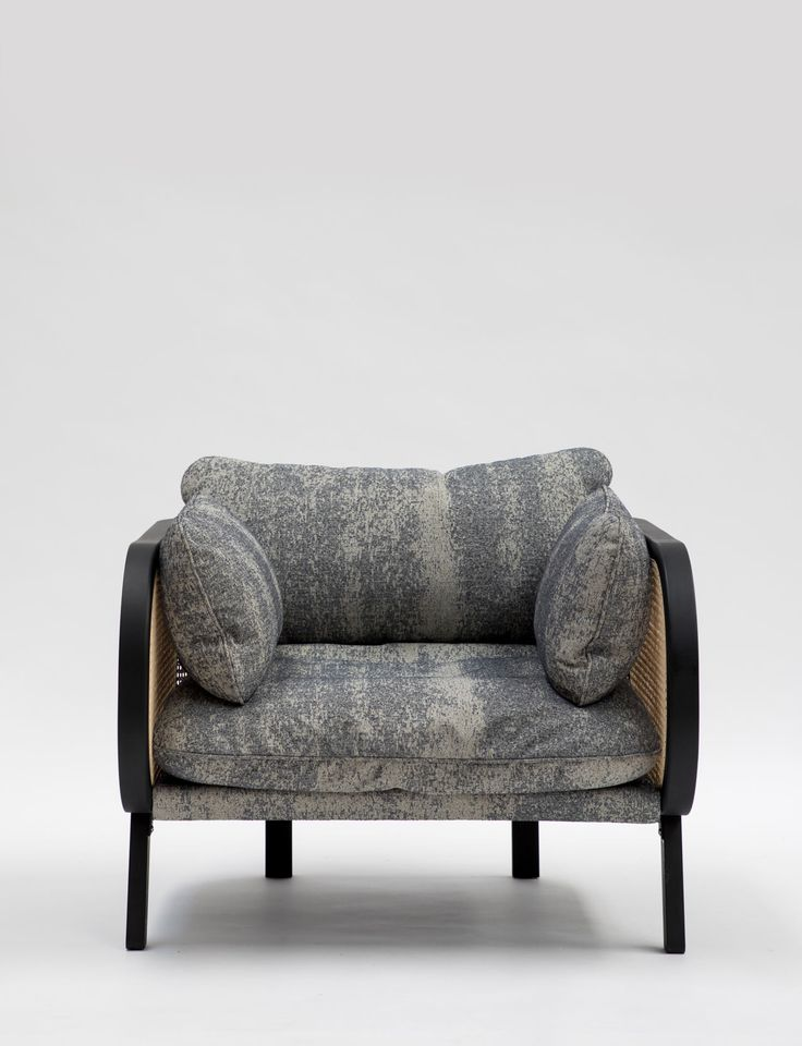 vintage-inspired, modern chair with a comfortable cushion and natural material