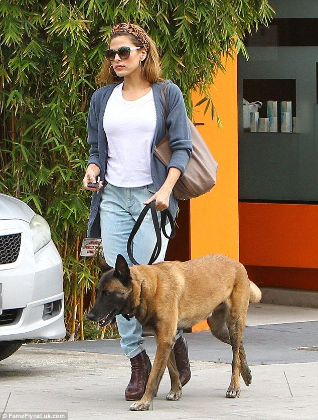 Dog day afternoon: Eva Mendes looked casually gorgeous in jeans and cardigan while running errands in Los Angeles with her trustworthy canine companion Hugo on Thursday