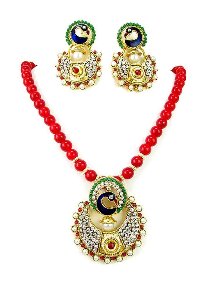 Tempting gold plated brass metal #Pendant with diamantes, #Pearls, mina work. Item Code ; JPD82093 http://www.bharatplaza.com/new-arrivals/jewellery.html