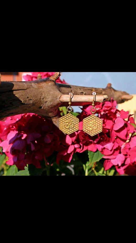 Check out this item in my Etsy shop https://www.etsy.com/dk-en/listing/483350181/boho-earrings-om-brass-earrings-boho