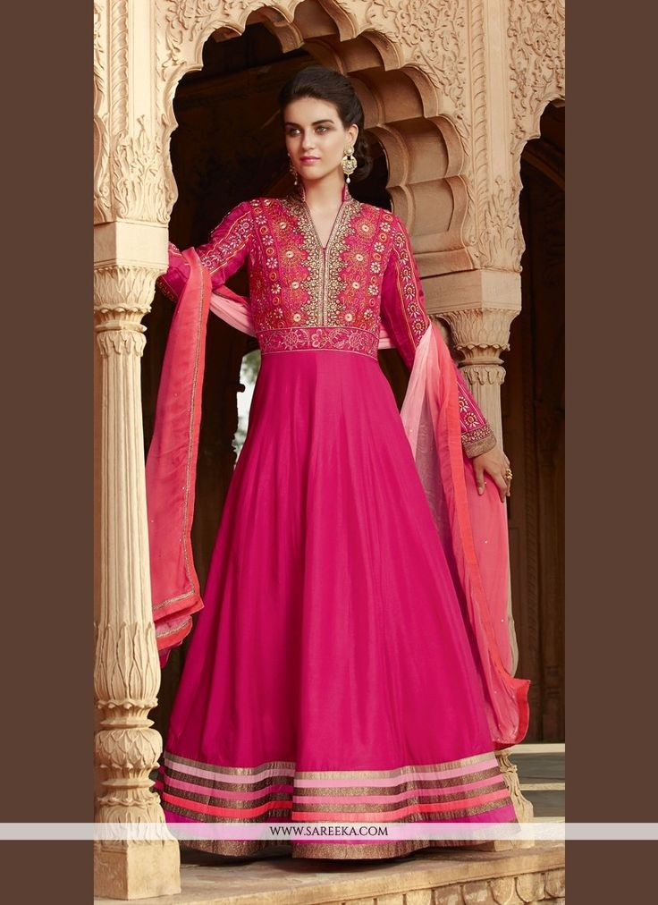 Make the heads flip as soon as you dress up with this hot pink georgette anarkali salwar kameez. Look ravishing clad in this dress that's enhanced embroidered and patch border work. Comes with matchin...