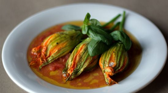 "Ricotta-Stuffed Squash Blossoms with Tomato Vinaigrette | Pure Wow...this might be a little ""too out of the box"" for D"