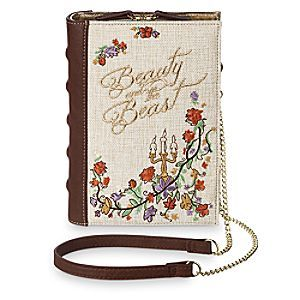 You will forever be thumbing the contents of Belle's stylish clutch bag in the shape of a finely bound padded book with embroidered cover detailing and golden faux leather trims. A shoulder strap with fine link chain will hold your place.