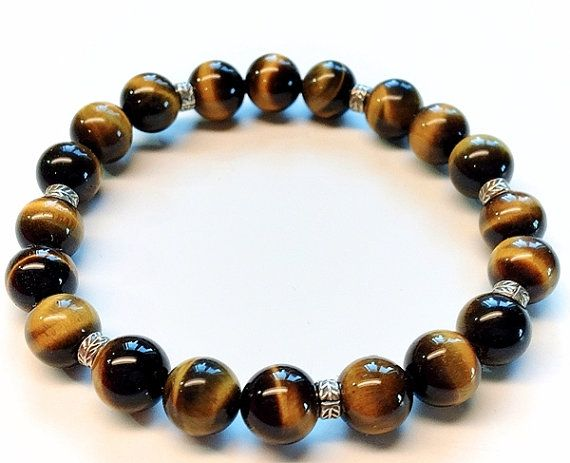 8mm AAA grade natural tiger eye bracelet with Karen hill tribe fine silver beads by Emmalishop  #tigereye #bracelet #hilltribe #silver #stretchbracelet #stone #beaded #etsy #handmade #jewelry #bohemian #tribal #gypsy #boho