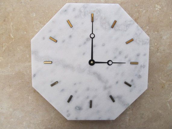 Elegant white marble wall clock  Stone: Classic Bianco Marble Hand Color: Black  Hour Markers: Gold raised dash.  Marble size: 12H x 12L x 3/8 W