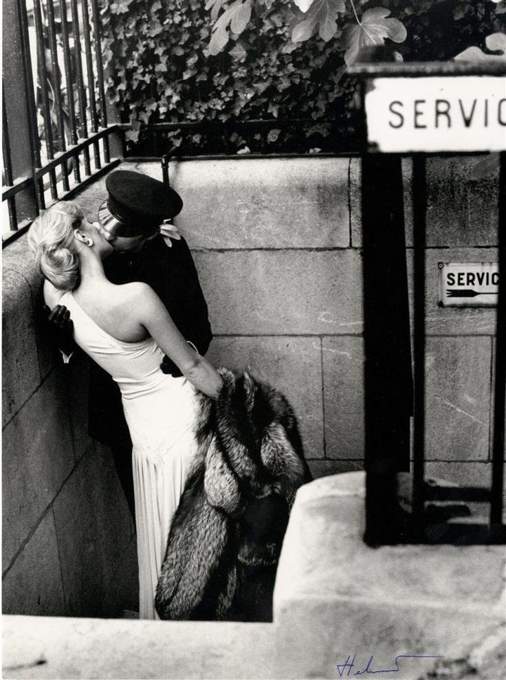 Helmut Newton, French Vogue 1976. Who wears an evening gown and furs on the street? I would, gladly.