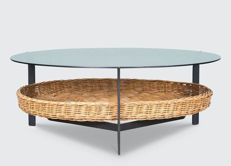 Lovely Dutch designed coffee table with a round glass top and a large rattan basket shelf for elegant storage. Simply beautiful!