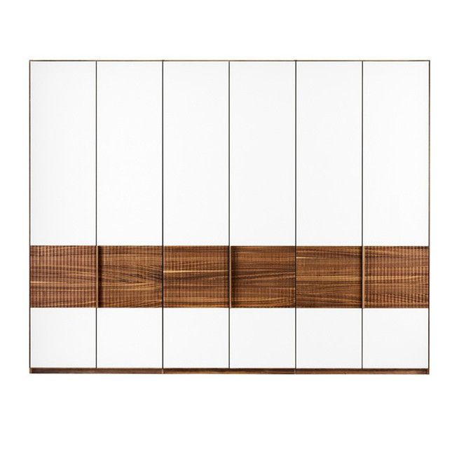 Jacob Strobel, 2010 Team7 The central section of the relief wardrobe front in reminiscent of a Greek column. The milling which runs across the wood g...