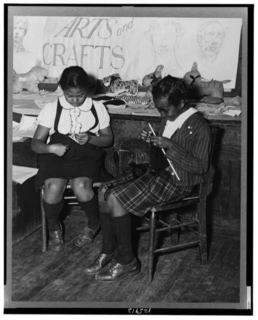 Philadelphia, Pennsylvania, March 1941, two girls busy knitting and making toy animals in the handicraft class of the St. Simon's Youth Center of the National Youth Administration.