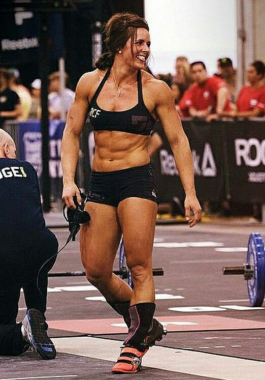CrossFit Stacie Tovar competition black thin strap sports bra pro shorts orange red shoes lifter Reebok