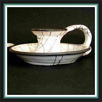 Svícen,  harisovaná keramika.