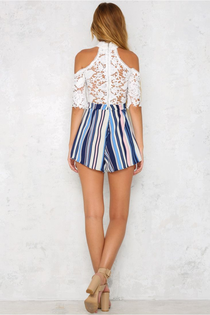 The Striped Tales Playsuit features a high neck, short off shoulder sleeves and gorgeous lace detailing over an inner padded bust. The visible back zip and multi coloured striped shorts add the finishing touches! Wear with chunky white sandals and a clutch!  Printed playsuit. Lined. Cold hand wash only. Model is a standard XS and is wearing XS. True to size. Non stretchy fabric. Polyester/spandex.
