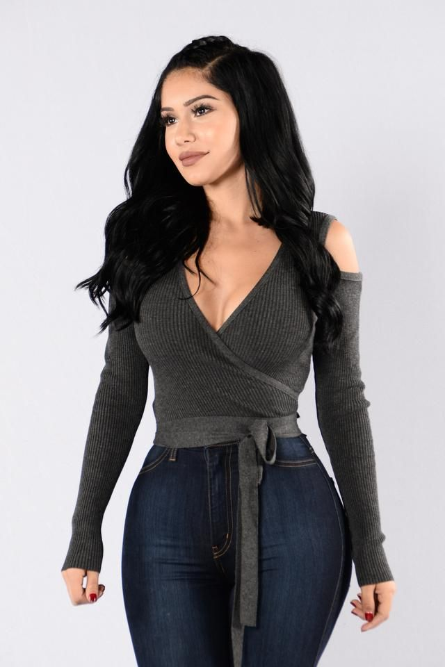 - Available in Charcoal and Sienna - Deep V Neckline - Cold Shoulder - Long Sleeve - Cropped - Tie Back Detail - 94% Acrylic, 6% Spandex