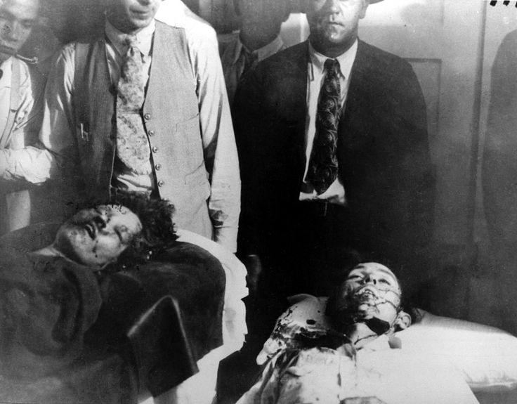 . Bonnie Parker, left, and Clyde Barrow are shown at the morgue in Arcadia, La., May 23, 1934. The bank robbers were ambushed by law enforcement officials who riddled their car with 167 bullets as they drove along a country road. (AP Photo)