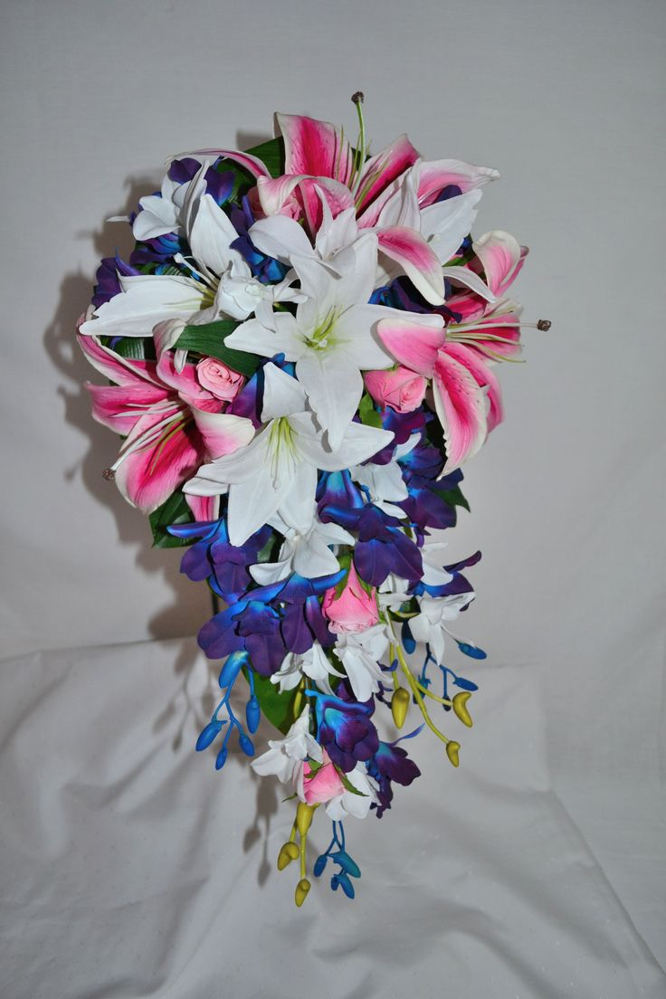 This impressive 55 cm long bouquet makes a real statement! Latex real touch lilies and hand dyed blue galaxy dendrobium orchids... guaranteed head turner!