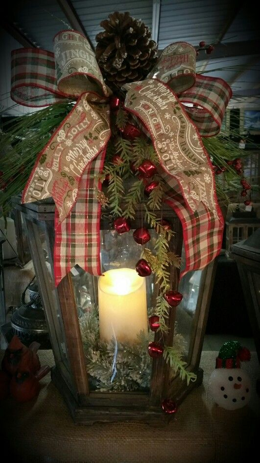 Wooden and metal lantern with holiday floral accent by Tim. More
