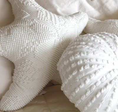 Handmade chenille starfish and anemone pillows that are perfect for a shabby chic cottage decor style.