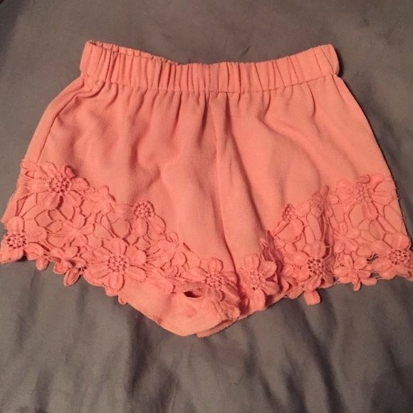 Peach shorts Peach shorts with lace detail. Elastic waistband so they stretch. Never worn! Shorts