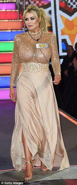 Thigh high: The star showed off her famous figure in the peachy coloured gown...