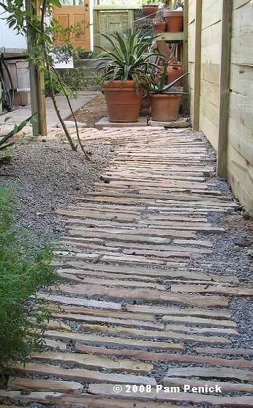 #1. Set horizontal stone strips in gravel walkway. Lay a Stepping Stones and Path Combo to Update Your Landscape