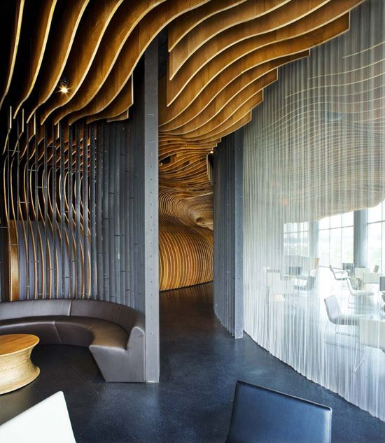 Cool wall and ceiling treatment. Probably couldn't pull it off at home but would make for a cool restaurant.