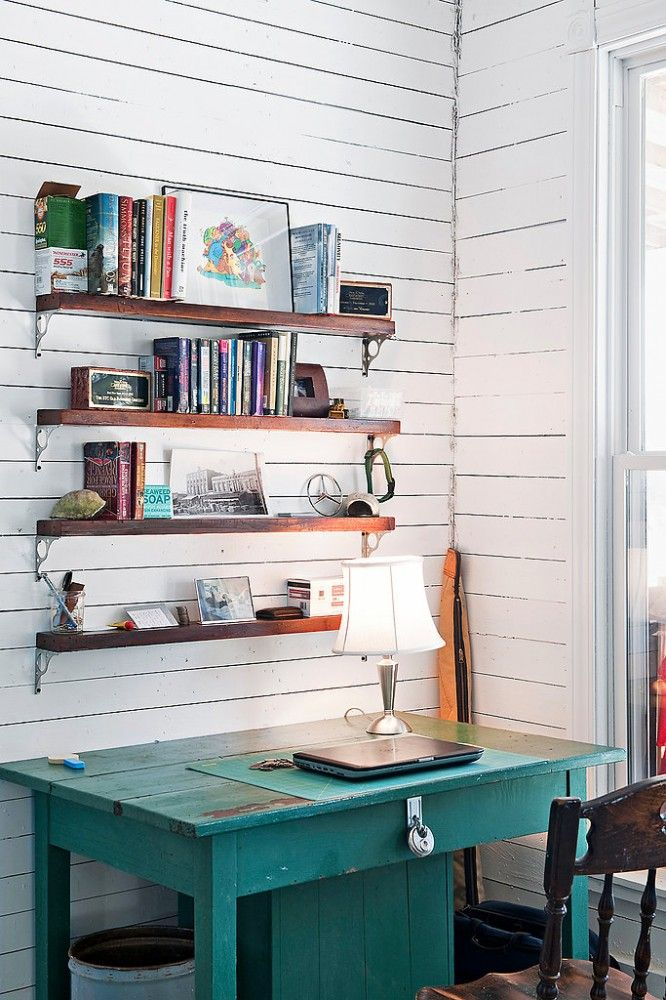 Open wood shelving and painted desks