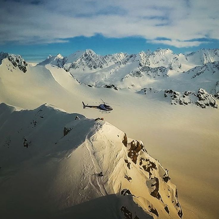HH Ambassador @ pointsnorthheli float above the mountains and clouds in Cordova, Alaska.