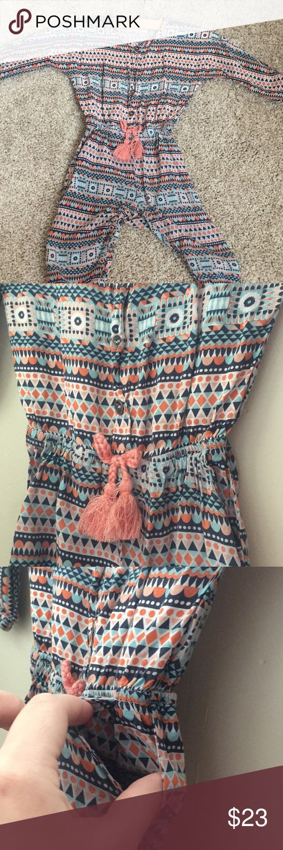 Jessica Simpson 9/12M aztect jumper/ pant romper Jessica Simpson 9/12 Months Aztec and multi colored jumper / Romper / pants Romper. Long sleeve and pants. Thin material. Worn once. {No trades or off poshmark transactions. Bundle to save. Ships same to next day. Smoke and pet free home} Jessica Simpson One Pieces