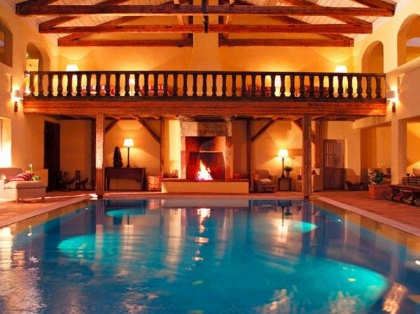 5 best wellness retreats a swimming pool with a fireplace the pool of the hotel zur bleiche in. Black Bedroom Furniture Sets. Home Design Ideas