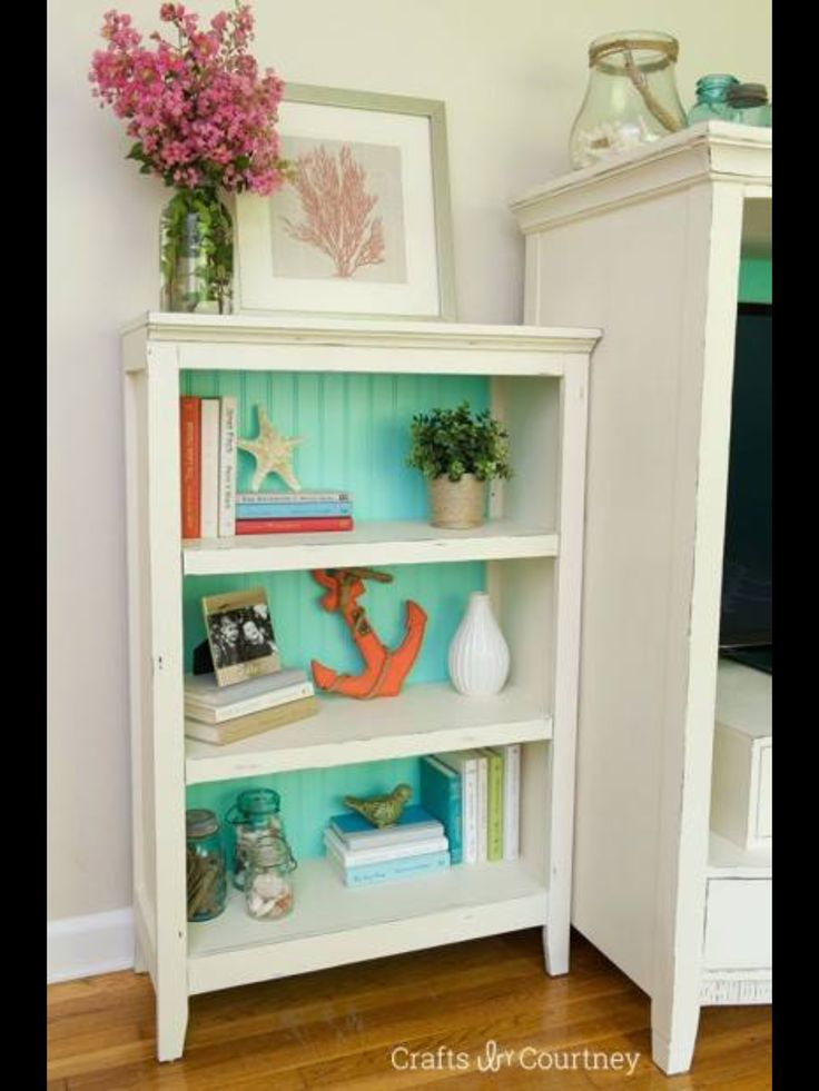Like the aqua beadboard on the open shelves. Great idea for extra storage in a…