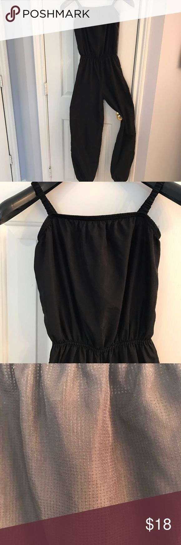 Body Wrappers Jumpsuit Ballet warm up Body Wrappers women's 12-14 black warm up Jumpsuit. Elastic at ankles and waist. Gently used, no flaws. 100% nylon. Body Wrappers Other