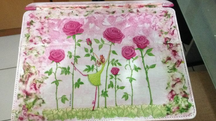Recycled ipad casing with decoupage