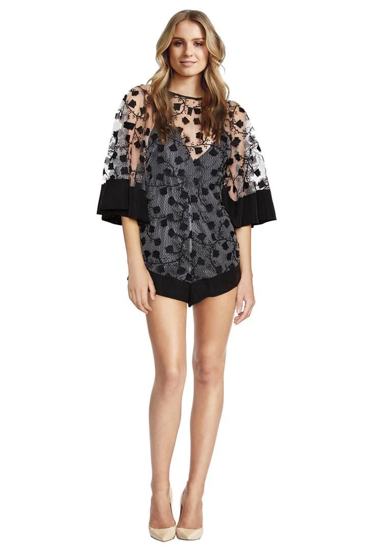 This adorable playsuit from Alice McCall features exquisite embroidered sheer fabric with a vine pattern all over. It has wide contrast banding at the cuff and hems and a deep V-neckline slip. This playsuit is flirty and fun – wear this with heels for a Summer wedding or sandals for a laidback event! Embroidered sheer fabric Wide contrast banding at the cuff and hems Deep V-neckline slip This style looks great on curvy and straight body shapes alike! Complete this look with pared-back…