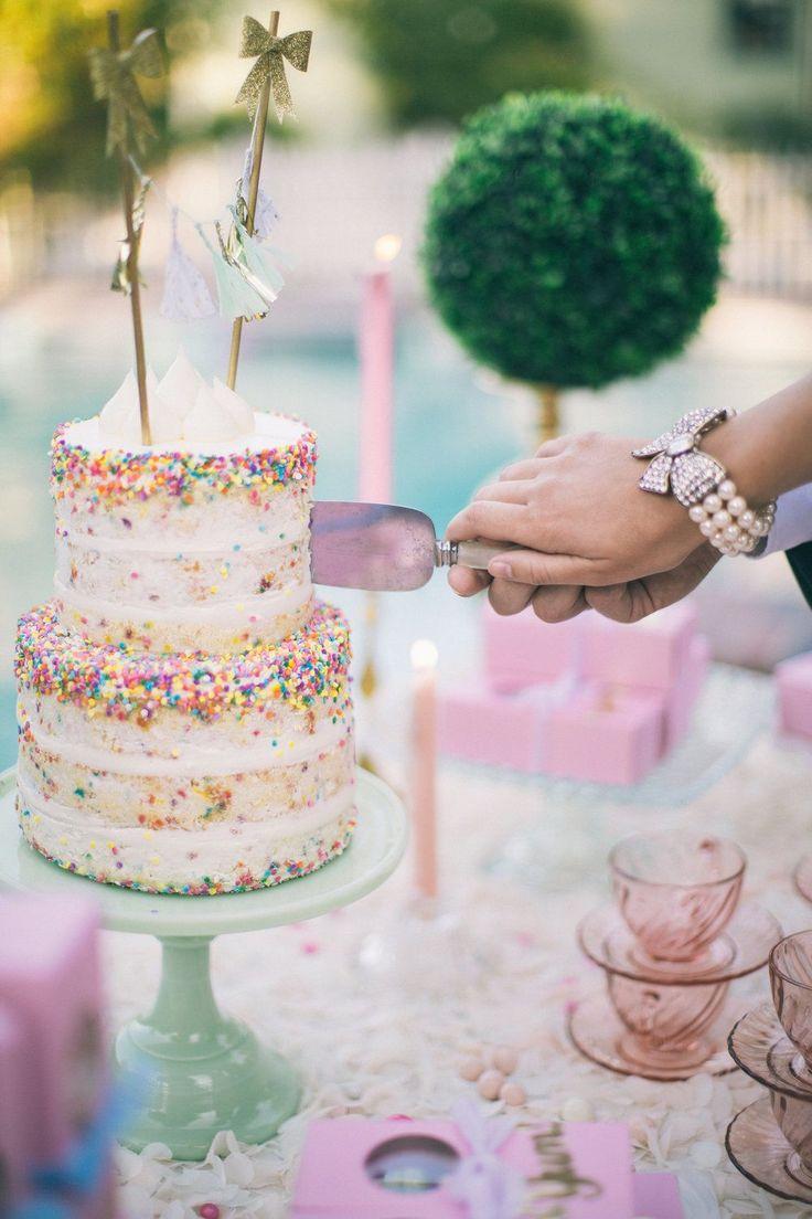 Funfetti wedding cake. Naked cake. Pastel cake table and dessert table decor. Cutting the cake. | Retro Pastel Inspired Shoot | Lovelyfest Event Design