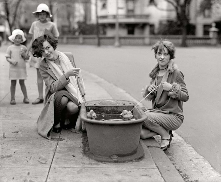 """historium:  """"Two young ladies let their pet ducklings take a swim in a horse watering trough, Washington, D.C. 1927  """""""