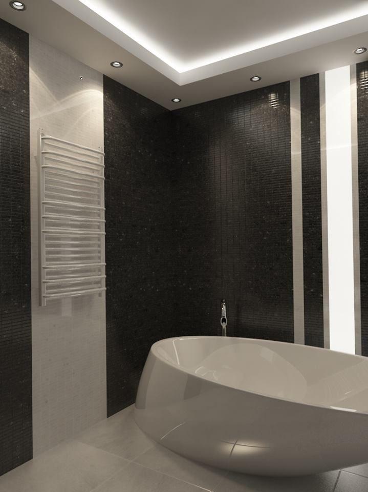 """Biało-czarna łazienka nie musi być nudna. Odpowiednie dodatki oraz oświetlenie odmienią aranżację, nadając jej nowoczesny charakter, tak by biel i czerń współgrała z minimalistycznym wystrojem. Nowoczesne łazienki to czyste formy, oszczędne kolory i świetnej jakości materiały. Prezentujemy Wam łazienkę MODERN według projektu """"Larkviz"""", w której grzejnik LUX-GP zachwyca swoją filigranową lekkością i perfekcyjnie harmonizuje z architekturą tego wnętrza."""