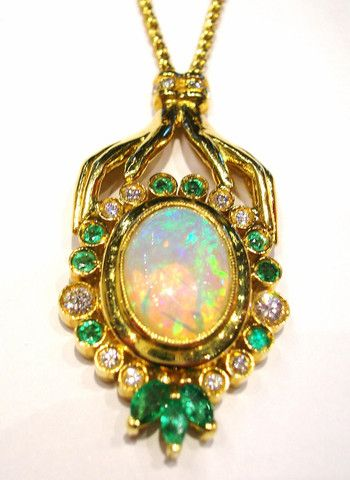 Bouquet d' Opale  This Pendant is realized with: White Opal, Emeralds, Diamonds brilliant cut and Yellow Gold.  White Oval Opal  2,40 kt.  Emeralds 0,26 kt.  Diamonds brilliant cut  0,59 kt.  F color  VVS 2  Yellow Gold 18 kt.  Total Weight  19,20 g.  4900$  Available only on Www.bangslove.com