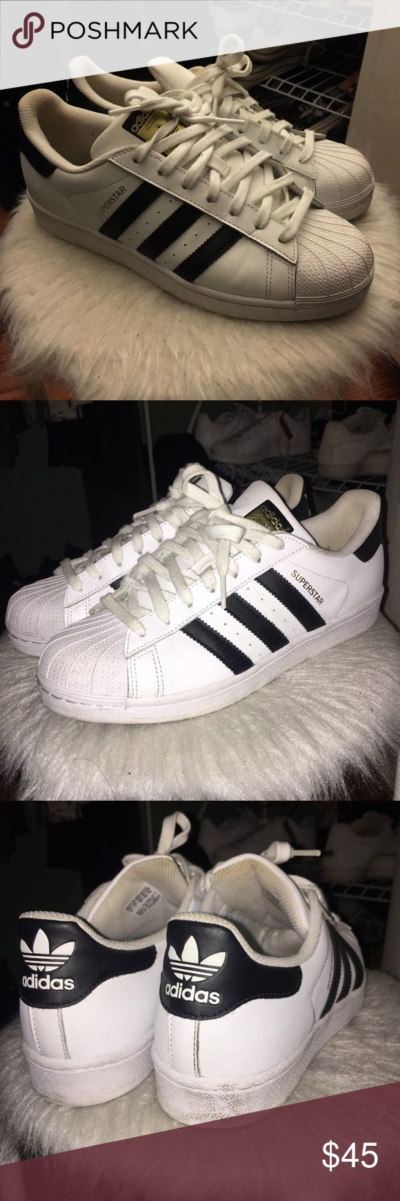 Adidas Superstar Originals Black and White Adidas Superstar Original shell toe sneakers! Gently used. Only wore about 3-4 times.  Men's 8.5 / Women's 9.5 (I'm a true W 10 and these are too snug on me)  Scuffs are shown in images and they're easily removable. Just needs a little scrub :) still a lot of life left in these!  Price negotiable. No lowballs please. Adidas Shoes Sneakers