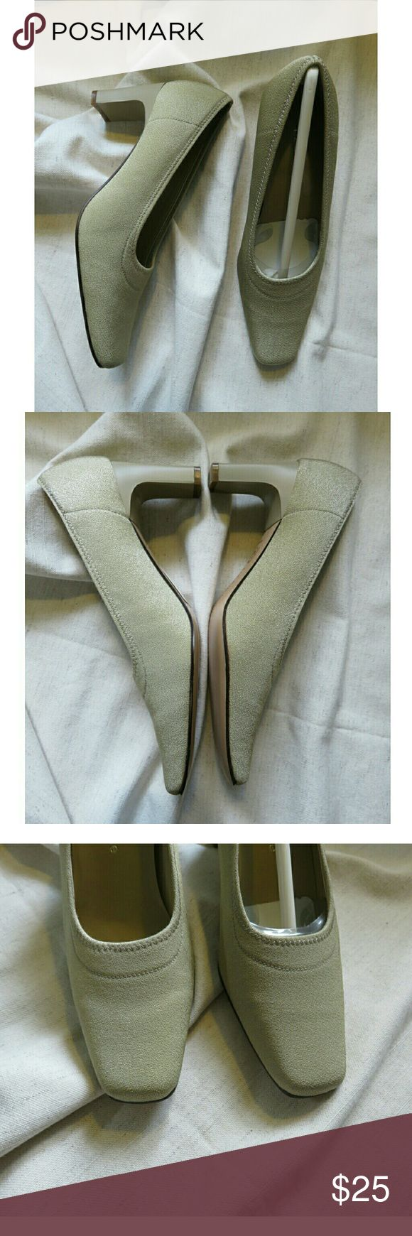 """NWT Vintage Liz Claiborne Gold Pumps 6.5 Wedding +New with boutique tags and never worn from Liz Claiborne (still has shaper paper in left shoe). Classic vintage gold/ivory pumps, feel like a metallic fabric but says leather. Ladies shoe size 6.5, heel is 2.5"""" high, mini scuff on right heel (pictured). Perfect from a unique vintage wedding shoe to work everyday!  So classic and chic! +Your purchase helps support local & national charities, and I'm a veteran reseller, fashion consultant, and…"""