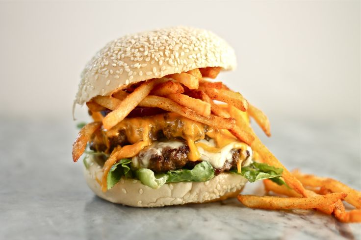 Classic American cheeseburger topped with seasoned fries