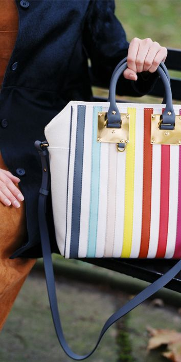 Add colour to your look with the Rainbow Canvas Cromwell Mini tote. Vertical stripes of coloured leather are appliqued to fresh white canvas. An interior zip ensures security. Signature Sophie Hulme details complete the style - polished gold-plated hardware, curved top handles and a detachable strap.