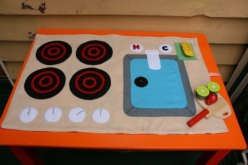 Great idea instead of buying a large bulky kitchen playset. Kitchen playmat by maika made, via Flickr