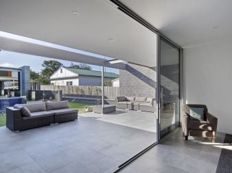 The sheltered outdoor area opens out to the yard