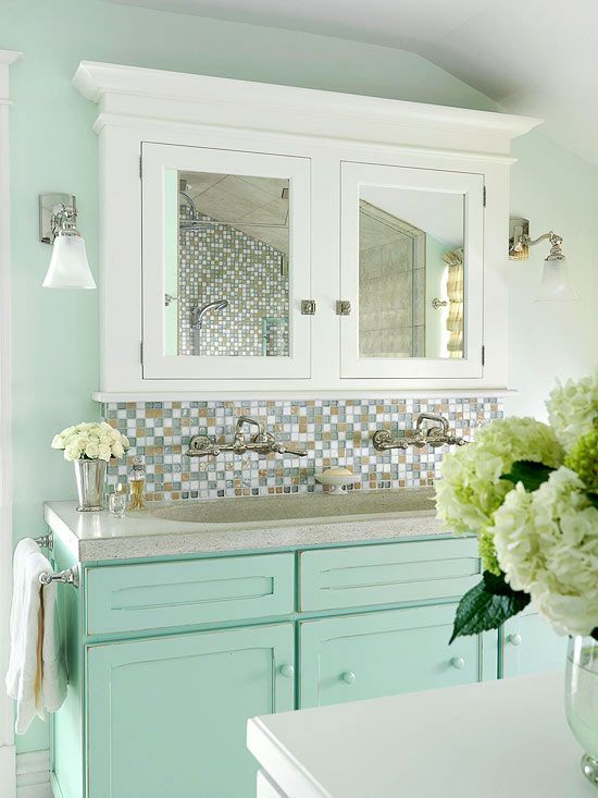 Ocean Blue + Sandy Brown + White  A soft palette of watery blue, sandy brown, and white creates a beachy vibe in this bathroom. The painted vanity cabinet matches the color of the walls, creating a seamless look. A mosaic tile backsplash along the wall behind the vanity adds a hint of sparkle and vintage appeal.