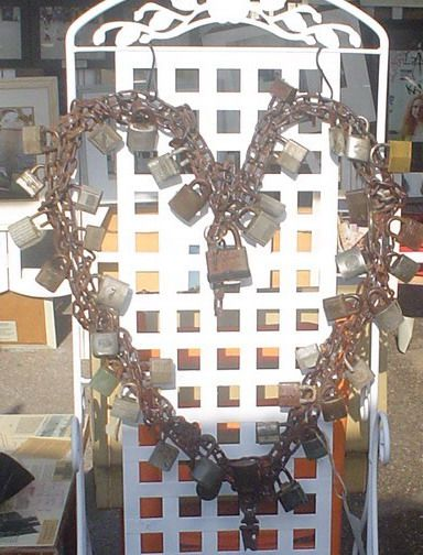 Heart welded from vintage locks and chain, an original recycled art sculpture by Dana Carrera, SOLD,  Recycle, upcycle, repurpose, salvage, diy!  For ideas and goods shop at Estate ReSale & ReDesign, Bonita Springs, FL
