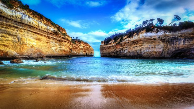 Loch Ard Gorge - Up nice, close and personal to the beach.  It's one of the things I like best at Loch Ard Gorge on the Great Ocean Road.  One of very few places you can walk down and get sand squished in between your toes.  A most amazing place to have a swim - and I saw a few English tourists even do so on a coldish day.  Guess it could have passed as a heat wave for them folk.  Best viewed in full screen..  www.paradigmblue.org  #PortCampbell   #Victoria   #Australia