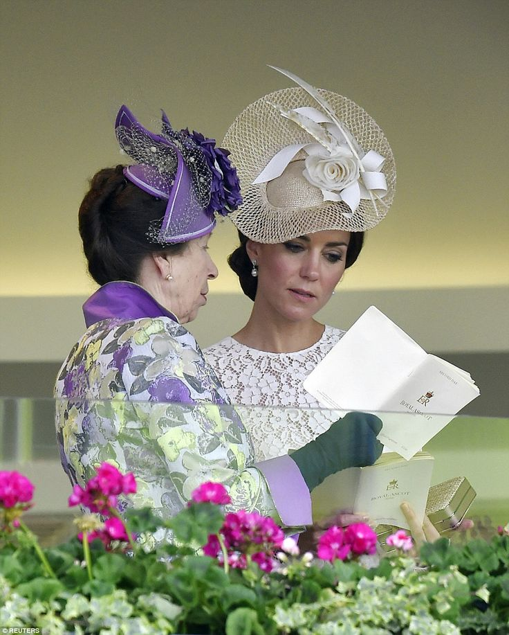 Later, the Duchess of Cambridge was spotted looking at an Ascot booklet with Princess Anne