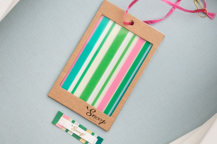 striped hangtag and label! Plastic matched with kraft paper and a lot of colour!
