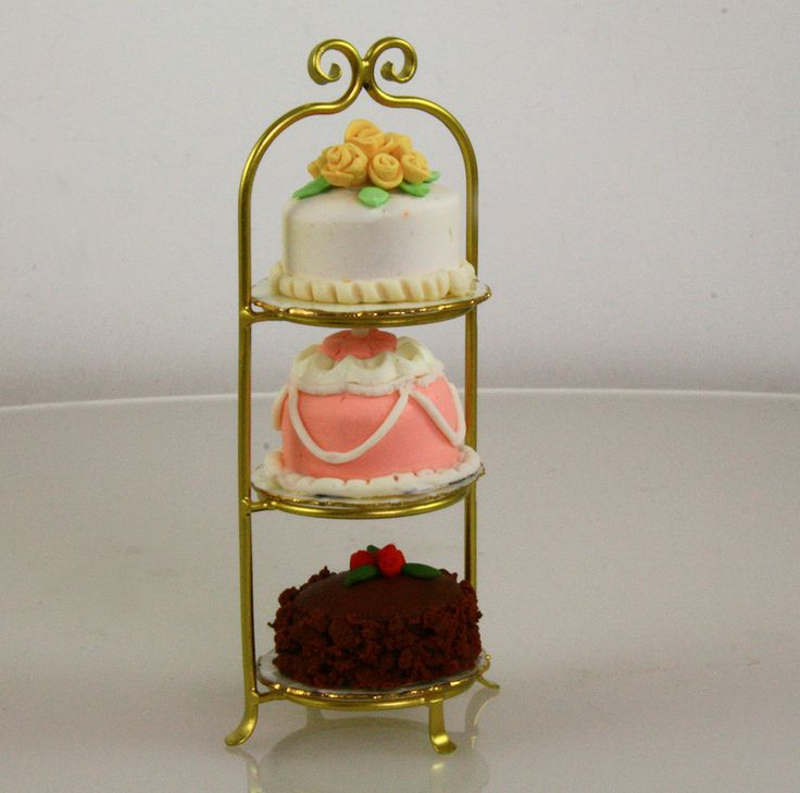 3 Tiered gold toned cake stand with 3 plates.  Handmade by  J. Getzan