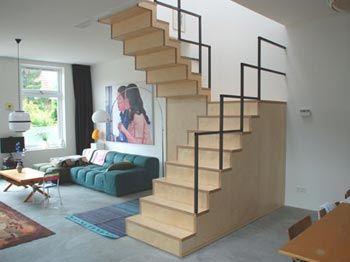 BLOK meubel - minimalistische moderne trap met trapkast en kubistische stalen leuning, ontworpen door BLOK meubel